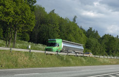 Green fuel truck and forrest Stock Photo