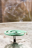 Green fumigator over glass table Stock Photography