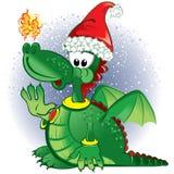 Green funny dragon wearing a Santa hat Stock Photo
