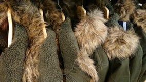 Green Fur Winter Coats. Seven Green Fur Winter coats in a row stock photos