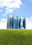 Green futuristic city background. Futuristic city background with green environmental friendly grassland foreground royalty free stock images