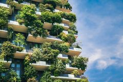 Green futuristic skyscraper close-up architecture