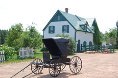 Green gables farmhouse. Farmhouse and horse buggy, location of the Anne of Green Gables novels, in Prince Edward Island, Canada stock image