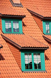 Green gables red tile roof. Architectural details of green roof gables on a red tiled roof royalty free stock photos