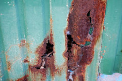 Green galvanized sheet with a hole of rust Royalty Free Stock Photos