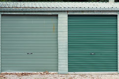 Green garage doors royalty free stock photography
