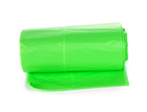 Green garbage bags rolls. On a white background stock image