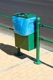 Green garbage basket Stock Photos