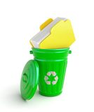 Green garbage bin with documents Stock Image