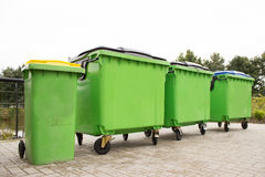 Green garbage containers in a row Stock Photos