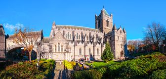 Green garden in autumn with Christ Church Cathedral during the sunny day in Dublin, Ireland. Dublin, Ireland. Green garden in autumn with Christ Church Cathedral Royalty Free Stock Photo