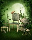 Green garden with a chair. Green fairy garden with a chair and yellow flowers Royalty Free Stock Images