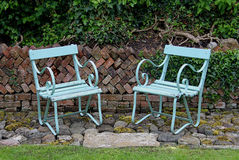 Green Garden chairs, Herringbone Wall Royalty Free Stock Photo