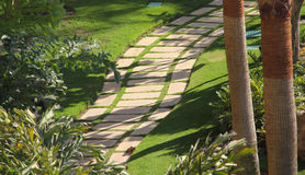 Green garden curved path Stock Photo