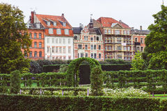 Green Garden and Danish Houses in Copenhagen. Green garden arch and scandinavian old houses in Copenhagen stock photo