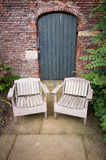Green Garden Door-Garden Seats-England-UK royalty free stock images