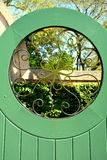 Green Garden Gate with Metal Insert Royalty Free Stock Images