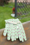 Green garden gloves on bench Royalty Free Stock Photo