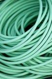 Green garden hose. Close up on a green garden hose royalty free stock photography