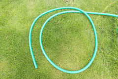 Green garden hose Royalty Free Stock Photo