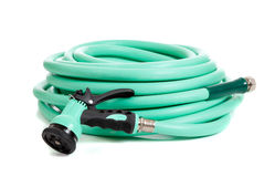 Green garden hose on a white background Stock Photos