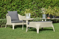 Green garden with an outdoor furniture lounge group Royalty Free Stock Photography