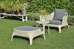 Green garden with an outdoor furniture lounge group Stock Photography