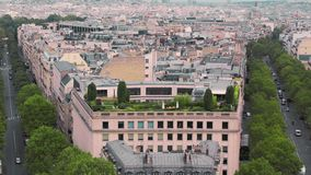 Green garden on the roof of the house of Paris, France Slow Motion. Cityscape cars on the road. Shot from the arch of stock video
