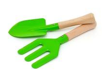 Green garden shovel and rake Stock Images