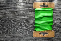 Green garden tie wire on wooden board Stock Images