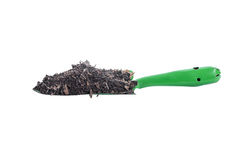Green Garden trowel with soil on white background Stock Images