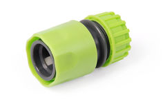 Green garden water hose nozzle and connectors. Isolated on white background with soft shadow. Photo with clipping path royalty free stock photo