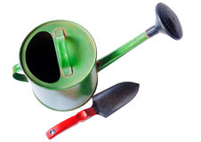Green  garden watering can and shovel isolated on white Royalty Free Stock Photo
