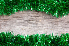 Green garland on the wooden background Royalty Free Stock Photo