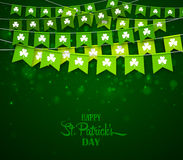 Green garlands of flags with clovers. Irish holiday Saint Patrick`s Day. Green festive bunting with clovers. Irish holiday, celebration party. Happy Saint Stock Image