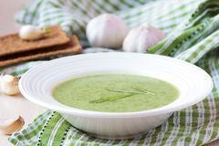 Green garlic cream soup with leaves rukola, arugula, healthy Royalty Free Stock Image
