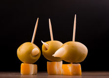 Green garlic stuffed olives and cheese cubes Stock Photo