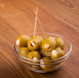 Green garlic stuffed olives in a glass bowl Stock Photo