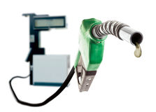 Green gas nozzle with one last drop of fuel Royalty Free Stock Photo