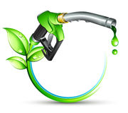 Green gas pump nozzle. With leaves Royalty Free Stock Photography