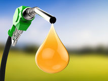 Green gas pump nozzle with droplet of oil Royalty Free Stock Photography