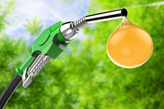 Green gas pump nozzle with droplet of oil Stock Photography