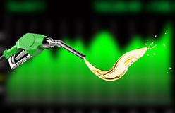 Green gas pump nozzle with oil splash Royalty Free Stock Images