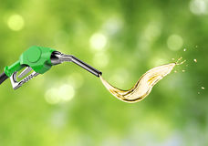 Green gas pump nozzle with oil splash Royalty Free Stock Photography