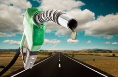 Green gas pump with one last drop. And the road on the background Stock Images