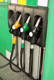 Green gas station with nozzles Royalty Free Stock Photo