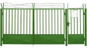 Green gate with barbed wire Royalty Free Stock Photography