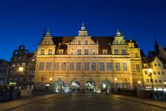 Green Gate in Gdansk at dusk. Cobblestone street and front view of the historic Green Gate, the formal residence of Poland`s monarchs, at the Main Town Old Town Royalty Free Stock Images
