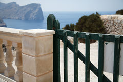 Green gate. Overlooking the rocky sea coast stock photography