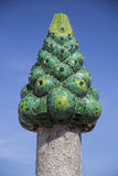 Green Gaudi Chimney. Barcelona, Spain - September 25, 2015: Gaudi Chimney, Palau Guell, Gaudi broken tile mosacis and strange decorated chimneys are evident in Royalty Free Stock Photos